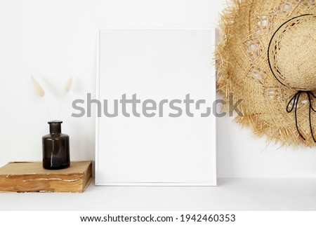 White photo frame mockup with straw hat