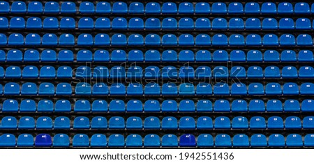 Seats at the stadium. shallow depth of field. Royalty-Free Stock Photo #1942551436