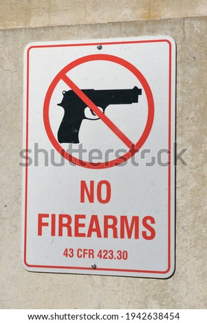 No firearms sign at Hoover Dam, Arizona, Nevada, USA Royalty-Free Stock Photo #1942638454