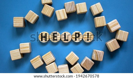 Support and help symbol. Wooden circles with the word 'help'. Business, psychology, support and help concept. Beautiful blue background, copy space. Royalty-Free Stock Photo #1942670578