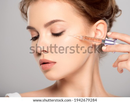 Woman in beauty salon. plastic surgery clinic. Cosmetology procedures concept. Royalty-Free Stock Photo #1942679284