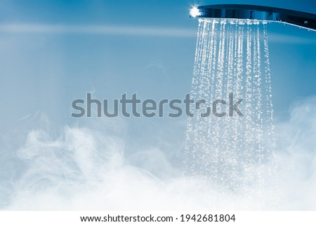 shower with flowing water and steam Royalty-Free Stock Photo #1942681804