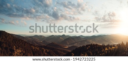 beautiful view above cloudscape and mountains Royalty-Free Stock Photo #1942723225