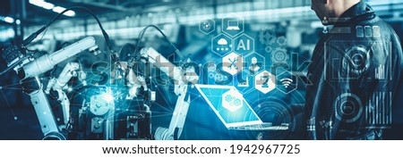 Smart industry robot arms for digital factory production technology showing automation manufacturing process of the Industry 4.0 or 4th industrial revolution and IOT software to control operation . Royalty-Free Stock Photo #1942967725