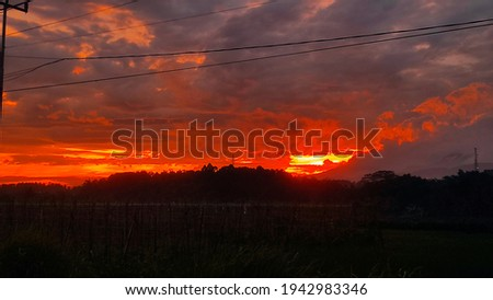 This photo is taken when im travel and see the moment of red crimson in the sky Royalty-Free Stock Photo #1942983346