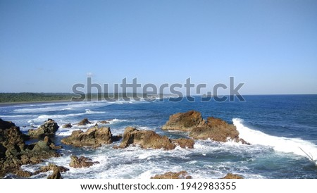 This is the photo when im travel to ranca buaya beach, i took this photo from the edge of cliff  Royalty-Free Stock Photo #1942983355