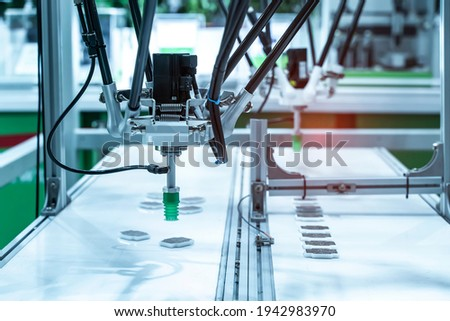 robotic pneumatic piston sucker unit on industrial machine,automation compressed air factory production Royalty-Free Stock Photo #1942983970