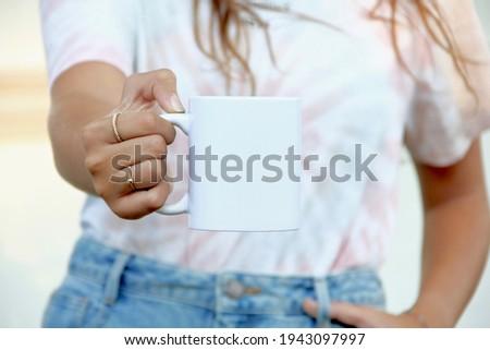 Woman holding white coffee mug.  white porcelain mug mock up
