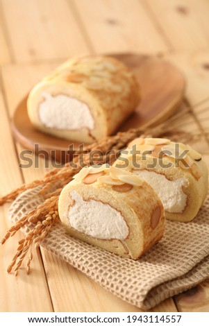 Delicious roll cake with fresh butter and eggs Royalty-Free Stock Photo #1943114557