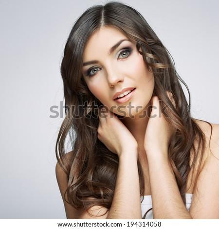 Woman beautiful face portrait. Skin care style face hand touching. Female model studio posing. #194314058