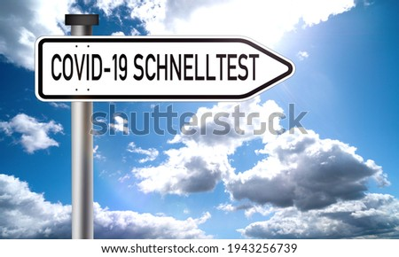 Schnelltest: corona covid 19 virus quick test - german text on road sign