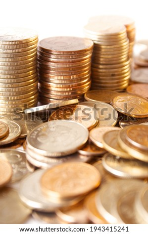 many of gold coins making curved path