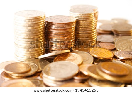 Many of gold coins over white background