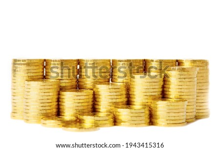 Gold towers made out of gold coins over white background
