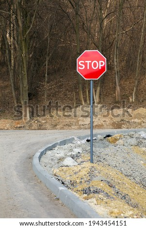 Stop sign. Traffic stop sign on the forest background. Vertical