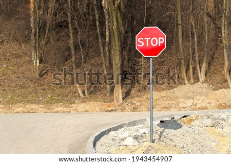 Stop sign. Traffic stop sign on the forest background. Horizontal
