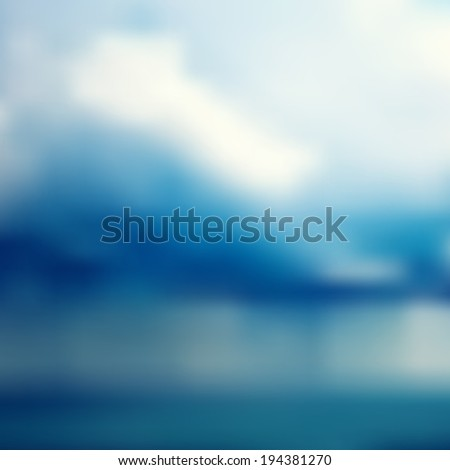 Nature blurred unfocused background. Sea and rainy clouds before storm.