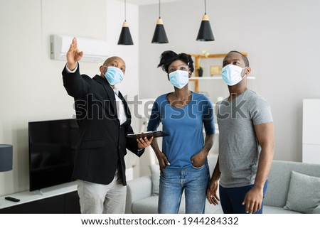 Real Estate House Tour With Realtor In Realtor Mask Royalty-Free Stock Photo #1944284332