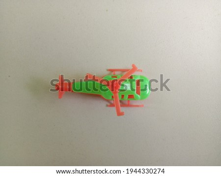Plastic toy helicopter on white background.
