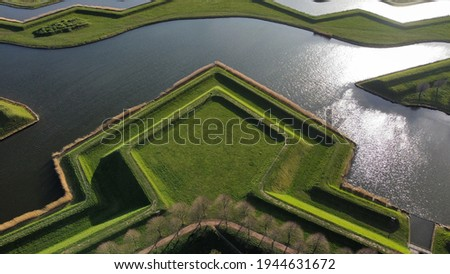 aerial view of a pentagon shaped grass field that was used as defense walls