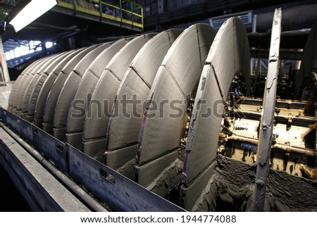 Ceramic vacuum filter in the iron concentrate drying process Royalty-Free Stock Photo #1944774088