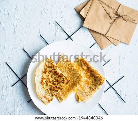 Russian cuisine. Homemade thin pancakes on plate. Place for inscription. Maslenitsa. Food for breakfast.Aesthetic. Pictures for restaurant and cafe menu.Traditional Russian dish. Discount day. Sale