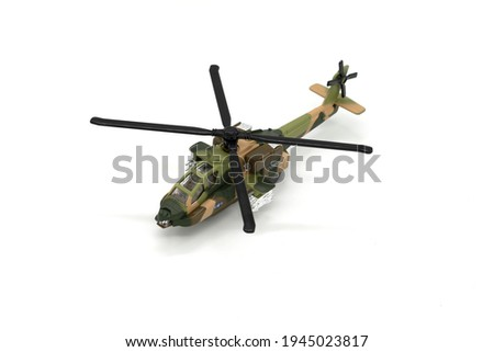 Plastic toy helicopter isolated on white background.