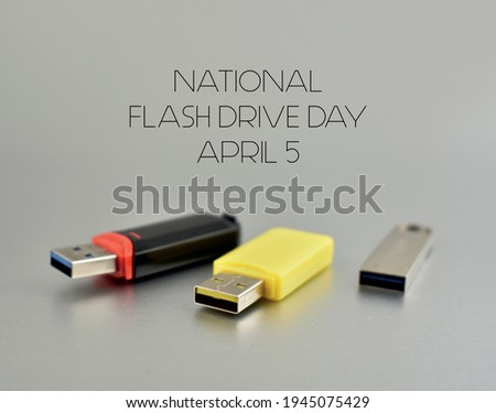 National Flash Drive Day stock images. Various USB flash drive on a silver background. Usb flash disk stock images. Flash Drive Day Poster, April 5. Important day Royalty-Free Stock Photo #1945075429