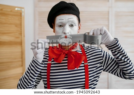 Mime artist with duct tape, parody comedy