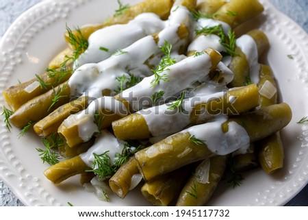 Turkish Food Broad Beans with Yogurt, Dill and Olive Oil  Zeytinyagli Bakla. Royalty-Free Stock Photo #1945117732