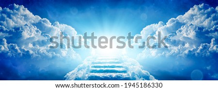 Stairway Through Clouds Leading To Heavenly Light Royalty-Free Stock Photo #1945186330