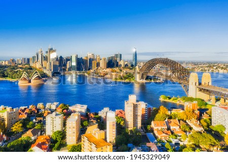 Circular Quay, THe rocks, Barangaroo and major Sydney city architectural landmarks on waterfront of Harbour - aerial view from Kirribilli. Royalty-Free Stock Photo #1945329049