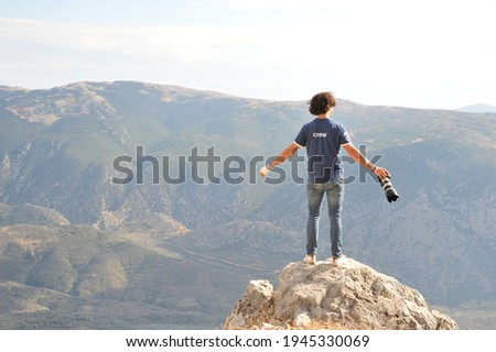 Photographer looking at a landscape