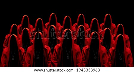 People dressed in a red robes looking like a cult members on a dark background. No face. Occult, sect concept.  Royalty-Free Stock Photo #1945333963