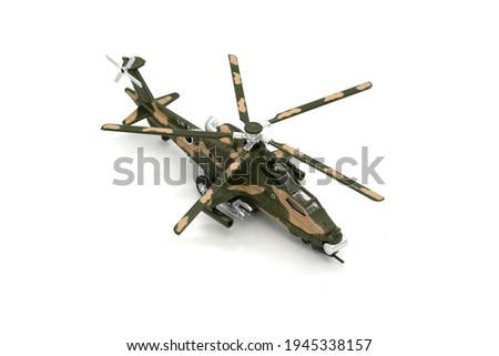 Brown plastic toy helicopter isolated on white background.