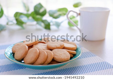 A famous treat called butter cookies or Butter Biscuits. Royalty-Free Stock Photo #1945492210