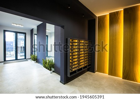 Interior of the corridor hall, apartment building  Royalty-Free Stock Photo #1945605391