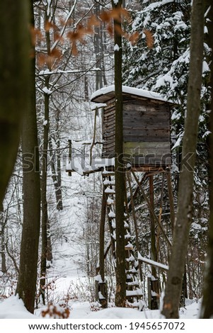 Photo of High stand for huntsmans, hunters and foresters in snowy winter forest