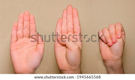 A signal for help is a gesture that can help people experiencing domestic violence. Royalty-Free Stock Photo #1945665568