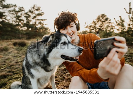 Young woman and dog doing video call