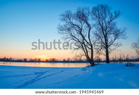Winter nature river dawn landscape. Sunrise winter snow dawn Royalty-Free Stock Photo #1945941469