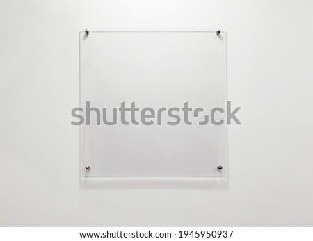 A transparent square acrylic board