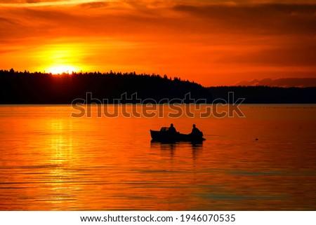Sunset lake boat fishing scene. Fishermen boat sunset fishing. Sunset lake fishing Royalty-Free Stock Photo #1946070535