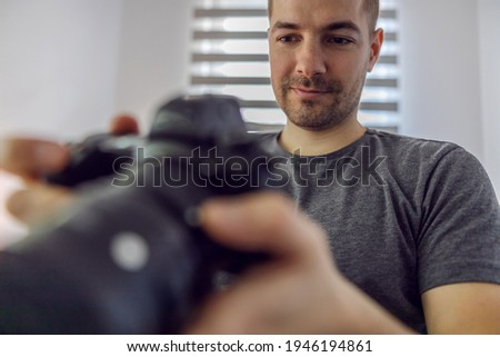 A man sets up a camera for the photo shooting to ensure the quality of photos and videos. Adjust the filter, sharpen the image, and set the lens.