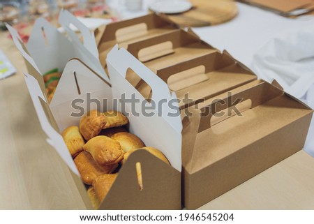 Many various take-out food containers, pizza box, coffee cups and paper bags on light grey background. Food delivery.