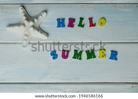 word hello summer is made up of volumetric color letters on a light blue wooden background, white starfish, summer time concept, vacation time, travel, boat trip, beach experience