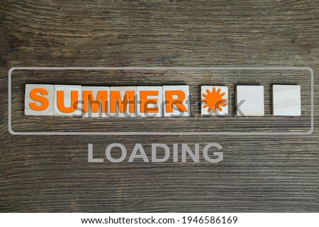 word summer in German is made up of volumetric letters on wooden background, white starfish, concept of summer time, vacation time, travel, boat trip, beach impressions, content download
