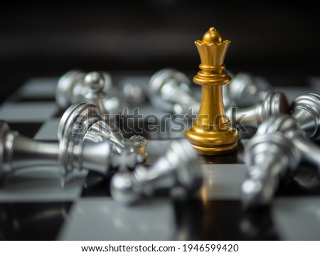 Chess. strategy ideas Planning and Decision concept business. gold queen chess surrounded by a number of fallen silver chess pieces , business strategy concept Royalty-Free Stock Photo #1946599420