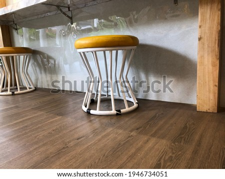 A picture of asymmetrical chairs in the cafe