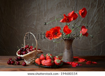 Poppy in a ceramic vase, cherries and strawberries on table #194680154